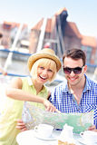 Young couple pointing at map Stock Photography