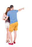 Young couple pointing. Stock Image