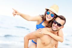 Young couple pointing at something at the beach Royalty Free Stock Photography