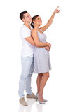Young couple pointing up Stock Photography