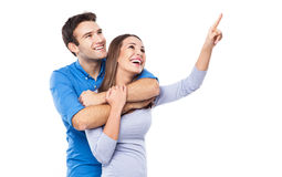 Young couple pointing up Royalty Free Stock Images