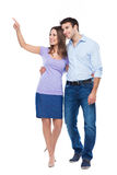 Young couple pointing up Royalty Free Stock Image