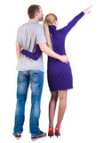 Young couple pointing at wal Back view Royalty Free Stock Image