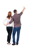 Young couple pointing at wal Back view Stock Image