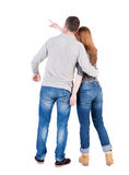 Young couple pointing at wal Back view  (woman and man). Royalty Free Stock Image