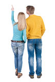 Young couple pointing at wal Back view  (woman and man). Stock Photography