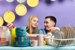 Young couple poiting at unwashed tablewear stock photo