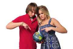 Young couple ponting to the earth Royalty Free Stock Images