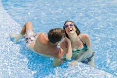 Young couple by pool Royalty Free Stock Photo