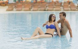Young couple by pool Royalty Free Stock Image