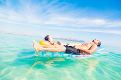 Young Couple With Pool Raft. Having fun in the mediterranean sea royalty free stock photos