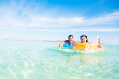 Young Couple With Pool Raft Royalty Free Stock Images