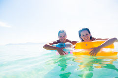 Young Couple With Pool Raft. Having fun in the mediterranean sea stock images