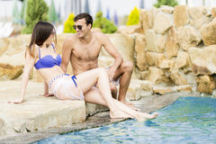 Young couple by the pool Stock Photos