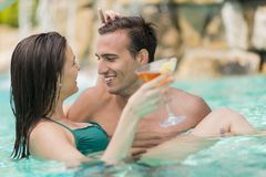 Young couple in the pool Stock Photos