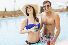 Young couple by the pool Royalty Free Stock Images