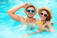 Young couple in pool. On sunny day stock images