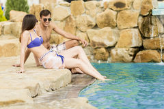 Young couple by the pool Royalty Free Stock Image