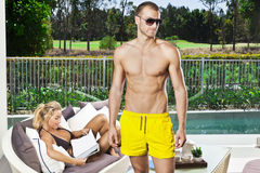 Young couple poolside Stock Photography