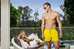 Young couple poolside Royalty Free Stock Images