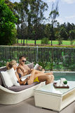 Young couple poolside Royalty Free Stock Photo