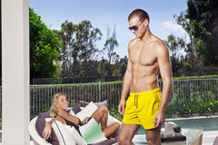 Young couple poolside Royalty Free Stock Photography