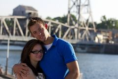 Young Couple Portrait in Front of a Bridge Royalty Free Stock Photos