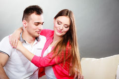 Young couple portrait on gray royalty free stock image