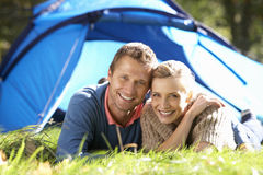 Young couple pose outside of tent Stock Photo