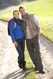 Young couple pose in park Royalty Free Stock Images