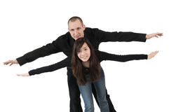 Young couple posing as biplane Stock Photo