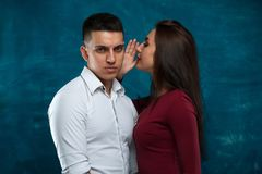 Young couple posing on blue background Royalty Free Stock Photos