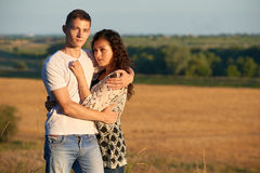 Young couple posing on country outdoor in evening, romantic and tenderness concept, summer season Stock Photos