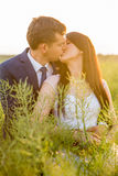 Young couple posing on a field. After marriage Royalty Free Stock Images
