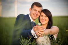 Young couple posing on a field. After marriage Royalty Free Stock Image