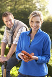 Young couple posing in garden Royalty Free Stock Image