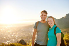 Young couple posing on a hike together with picturesque view Royalty Free Stock Photos