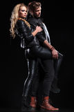 Young couple posing in leather clothes Stock Images
