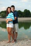 Young couple posing near a lake Stock Image