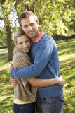 Young couple posing in park Royalty Free Stock Images