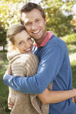 Young couple posing in park Stock Photo