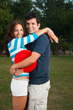 Young couple posing in park Stock Photography