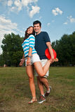Young couple posing in park Stock Photos
