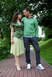 Young couple posing at park Stock Image
