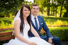 Young couple posing in park Royalty Free Stock Photo