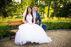 Young couple posing in park Royalty Free Stock Photos
