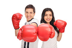 Young couple posing with red boxing gloves Royalty Free Stock Images