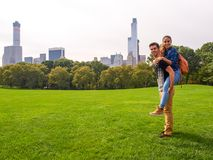 A young couple posing at Sheep Meadow in Central Park, NY, New York stock photos