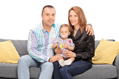 Young couple posing with their baby daughter Stock Image