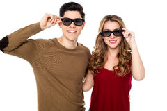 Young couple posing to camera with shades on Royalty Free Stock Photo